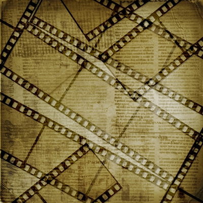 Filmstrip negatives overlaid upon a background script whose text is too obscured to read.