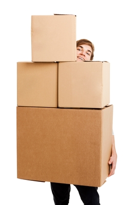 An employee peeks out from behind 4 large boxes he's holding; 49 KB.