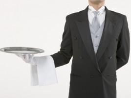 butler holding silver platter