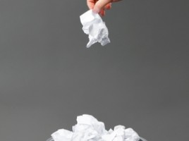 Putting crumpled paper in wastebasket