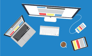 Bird's eye view of laptop on left, desktop computer in middle with smartphone plugged in, and tablet with coffee on the right.